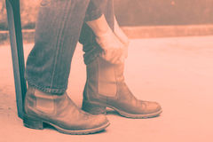 Woman wearing a boots. Royalty Free Stock Photography