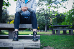 Woman wearing boots sitting on bench Royalty Free Stock Photos