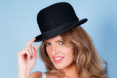 Woman wearing a bowler hat Stock Photo