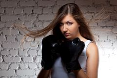 Woman wearing boxer gloves Stock Image