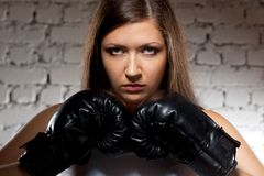 Woman wearing boxer gloves Royalty Free Stock Image