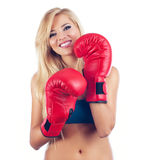 Woman wearing boxing glove Royalty Free Stock Photo