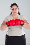 woman wearing boxing gloves Royalty Free Stock Images