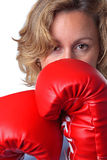 Woman wearing boxing gloves close up Stock Images