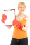 Woman wearing boxing gloves keeping clipboard Royalty Free Stock Photo