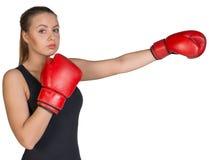 Woman wearing boxing gloves, in punching pose Stock Photos