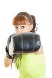 Woman wearing boxing gloves ready to fight and punching or hitti Royalty Free Stock Photography