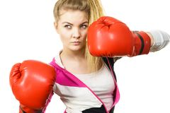 Woman wearing boxing gloves stock photos