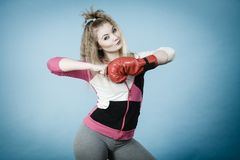 Woman wearing boxing gloves Stock Images