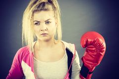 Woman wearing boxing gloves royalty free stock photos