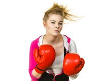 Woman wearing boxing gloves stock photography