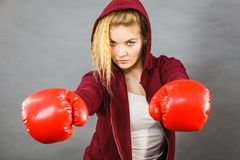 Woman wearing boxing gloves royalty free stock photography