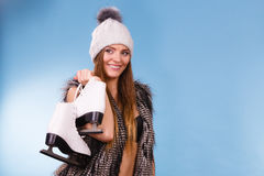 Woman wearing bra and holding ice skates Royalty Free Stock Photo