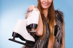 Woman wearing bra and holding ice skates Royalty Free Stock Photos