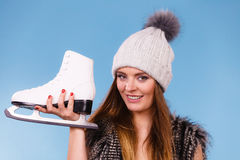 Woman wearing bra and holding ice skates Stock Photos