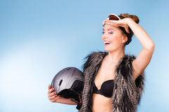 Woman wearing bra, holding ski helmet, looking up Royalty Free Stock Photo