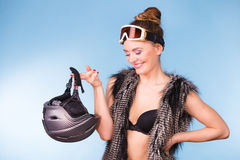 Woman wearing bra and holding ski helmet Royalty Free Stock Photo