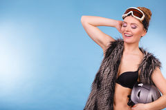 Woman wearing bra and holding ski helmet Stock Photos