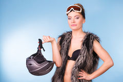Woman wearing bra and holding ski helmet Royalty Free Stock Photos