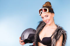 Woman wearing bra and holding ski helmet Stock Images