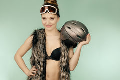 Woman wearing bra and holding ski helmet Stock Image