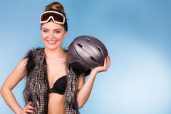 Woman wearing bra and holding ski helmet Stock Photography