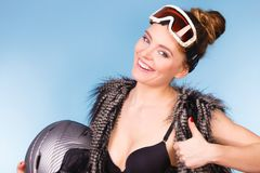 Woman wearing bra and holding ski helmet Royalty Free Stock Photography
