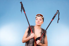 Woman wearing bra and holding ski poles Stock Photo
