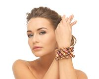 Woman wearing bracelet with beads stock photo