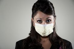 Woman wearing a breathing mask Stock Photo