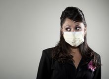 Woman wearing a breathing mask Stock Images