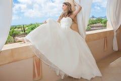Woman wearing bride or graduation dress Royalty Free Stock Photos