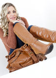 Woman wearing brown boots Stock Images