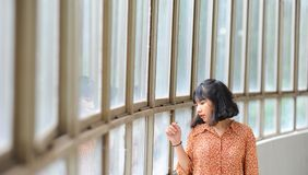 Woman Wearing Brown Dress Shirt While Sigh Seeing in Window Stock Photography