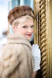 Woman Wearing Brown Fur Coat With Gloves an Hat Stock Image