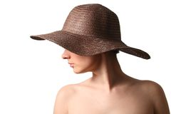 Woman wearing brown straw hat Stock Images