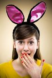 Woman wearing bunny ears Royalty Free Stock Image