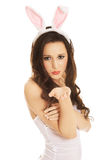 Woman wearing bunny ears and blowing a kiss Stock Photo