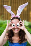 Woman Wearing Bunny Ears and Silly Egg Eyes Royalty Free Stock Photos