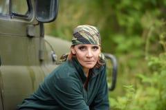 Woman wearing camouflage bandana royalty free stock photo