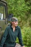 Woman wearing camouflage bandana royalty free stock image