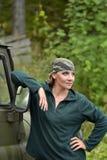 Woman wearing camouflage bandana stock photography