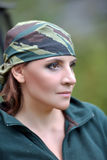 Woman wearing camouflage bandana against the backdrop of UAZ Stock Photography