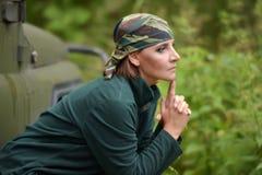 Woman wearing camouflage bandana royalty free stock images