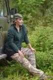 Woman wearing camouflage bandana stock photo