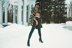 Woman Wearing Camouflage Jacket Standing on Snow Royalty Free Stock Photography