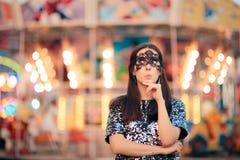 Woman Wearing carnival Mask at Funfair Amusement Park Royalty Free Stock Photography