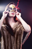 Woman  wearing  carnival venetian mask on blur background.  Stock Photos