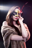 Woman wearing carnival venetian mask on blur background. stock images