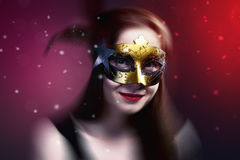 Woman wearing carnival venetian mask on blur background. royalty free stock images